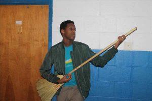 boy plays broom