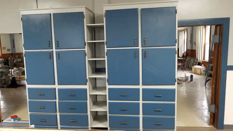 Old cabinets repainted with new adjustable shelves in the center