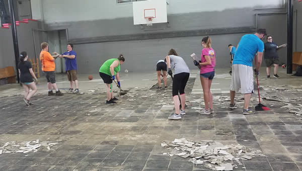 Friendship Wes. Church youth work team - scraping up gym tile